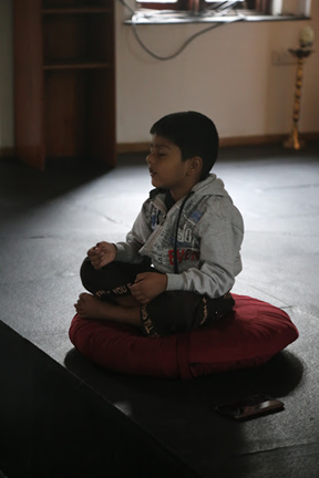 Boy Doing Sadhana